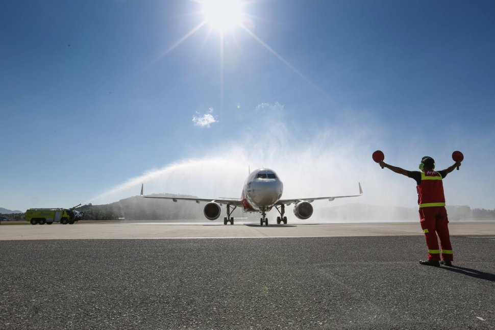 AirAsia flight receiving a water salutation at klia2