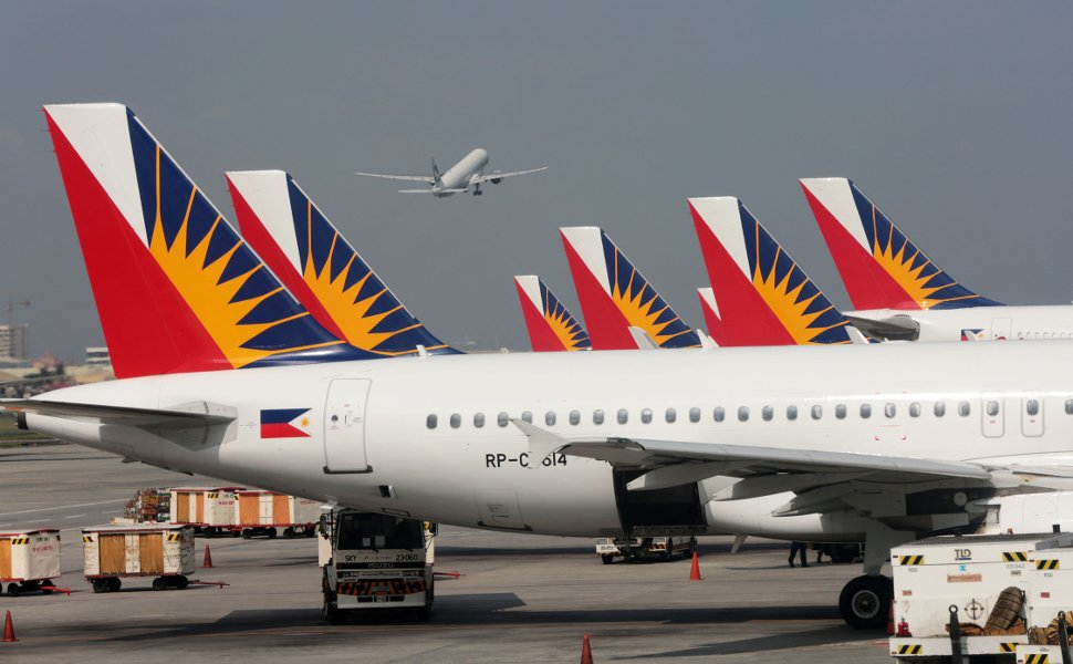 Philippine Airlines' flights waiting at the terminal