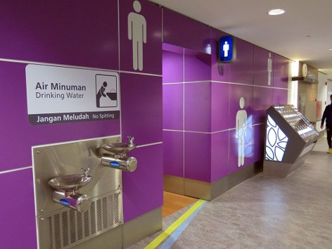 Toilets & water dispenser near Gate P8