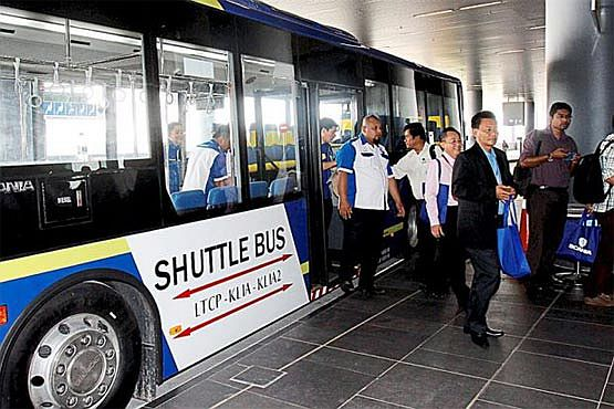 All aboard: The free shuttle bus carrying passengers and airport staff from the long-term car park to KLIA and KLIA2.