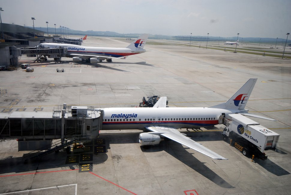 Malaysia Airlines flights parking at the contact pier