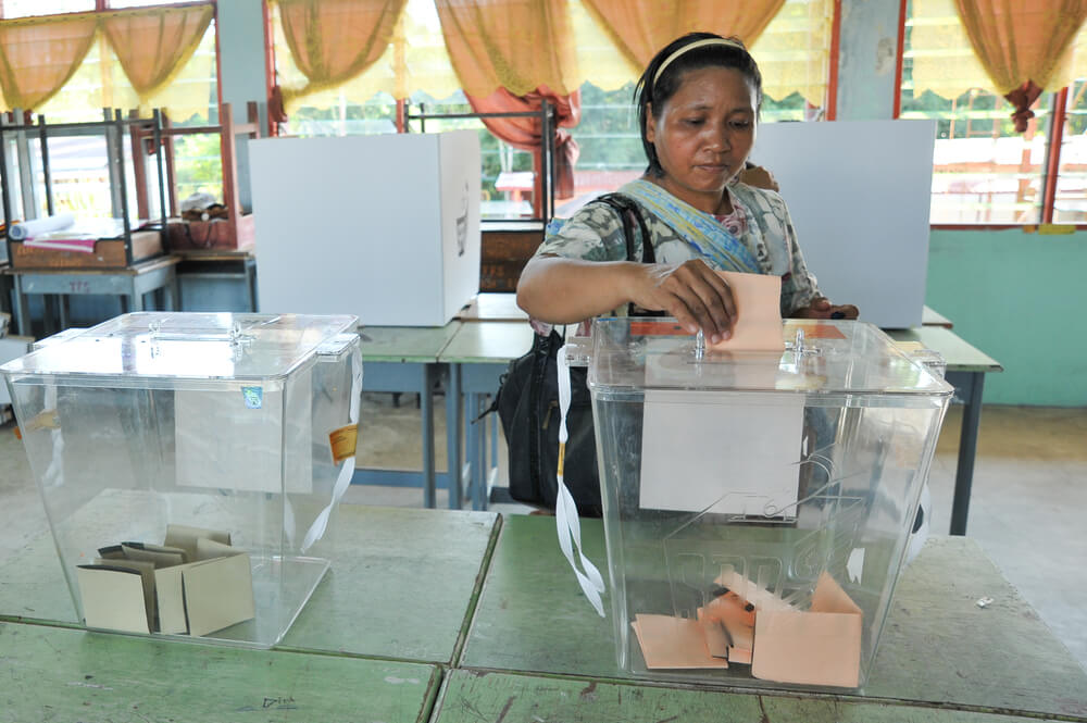 An unidentified Malaysian woman casts a vote during the 13th Malaysian general election on May 5, 2013, in Kiulu Sabah Malaysia