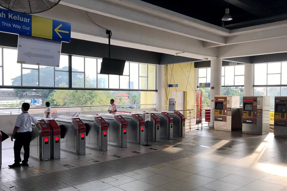 Faregates and ticket vending machines at station