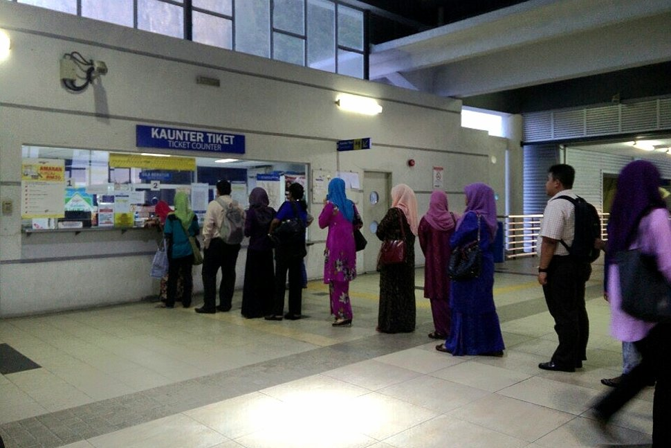 Commuters lining up for ticket purchase