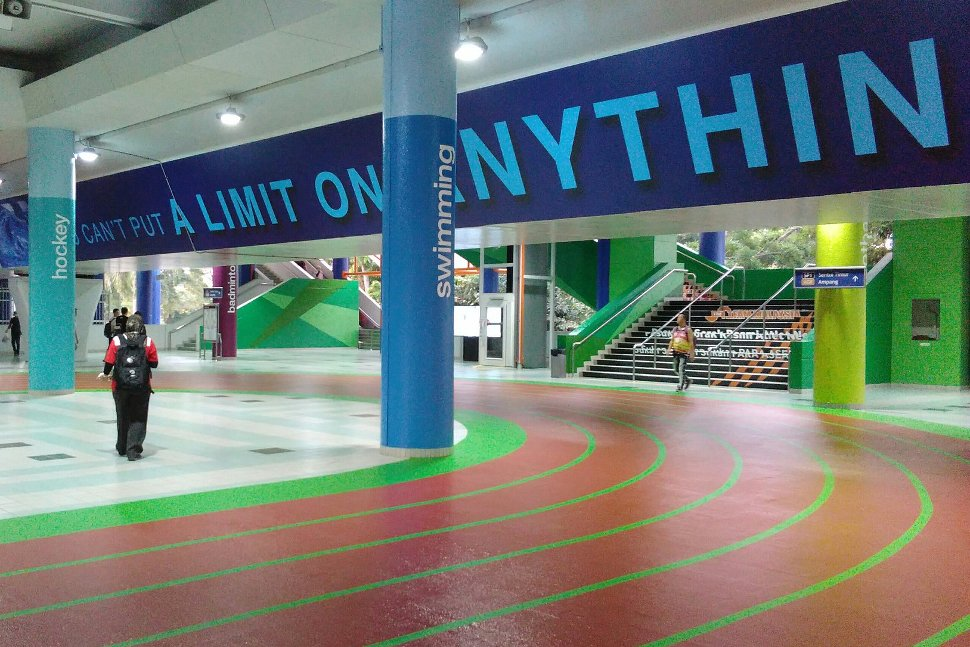 The concourse area of the station features sports-related quotes and the curve of the relay track.
