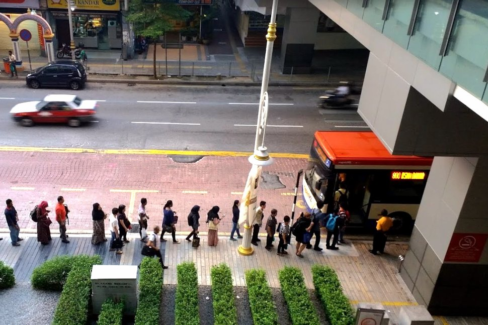 Commuters queuing up for the bus