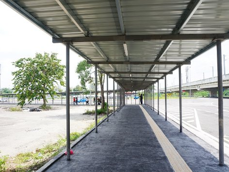 Follow the covered walkway