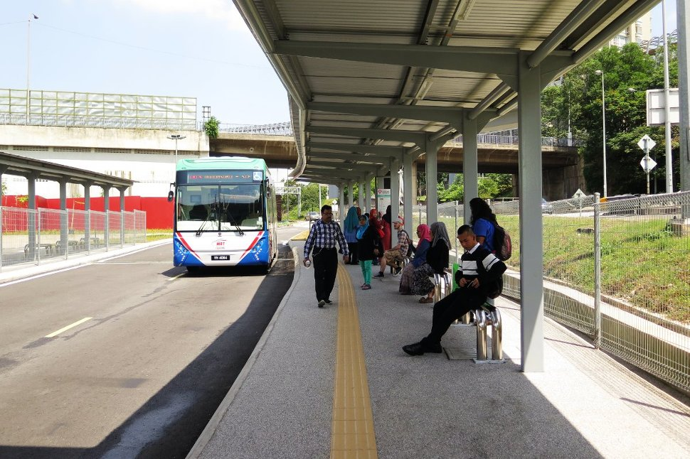 Commuters waiting for bus at the feeder bus hub