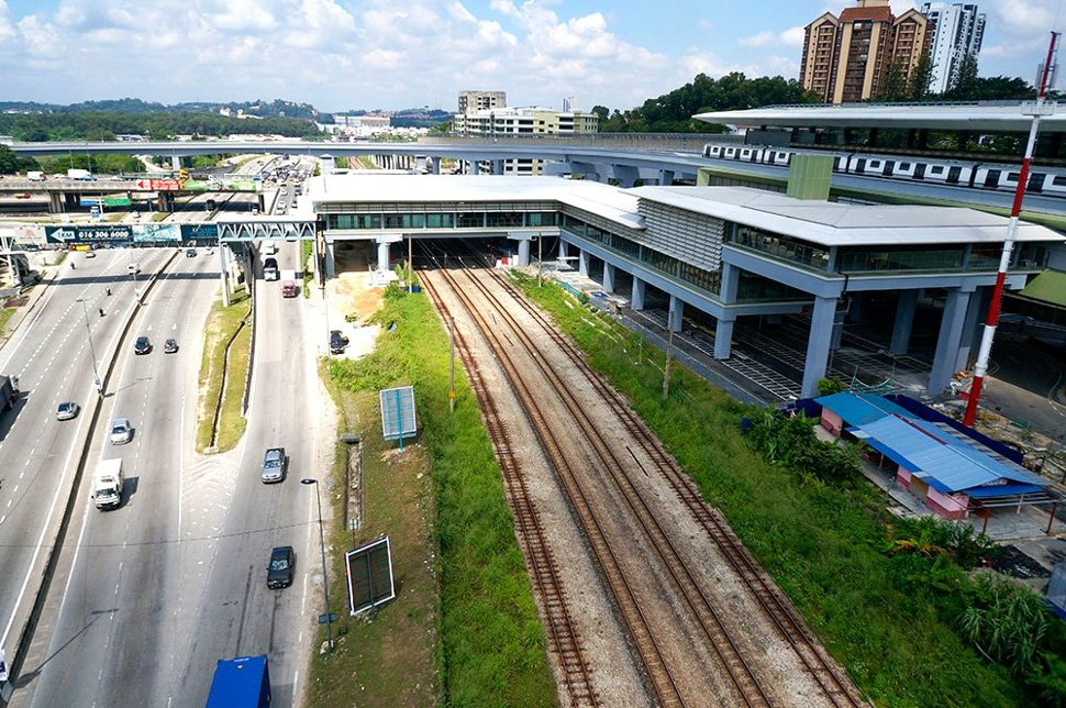 View of the completed Sungai Buloh MRT Station with the common concourse with the Sungai Buloh KTM Station over the KTM tracks