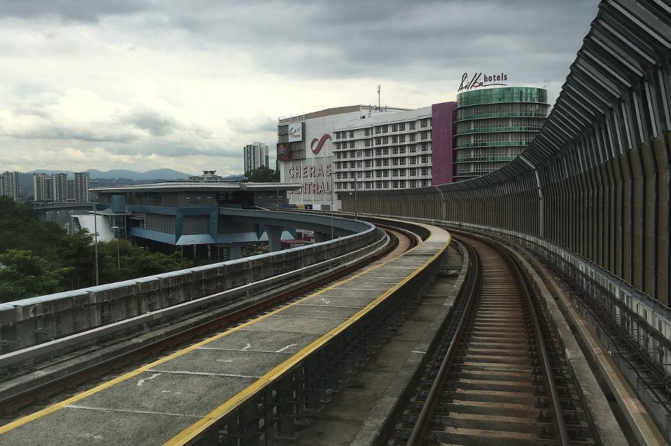View of the Taman Connaught MRT Station from a train