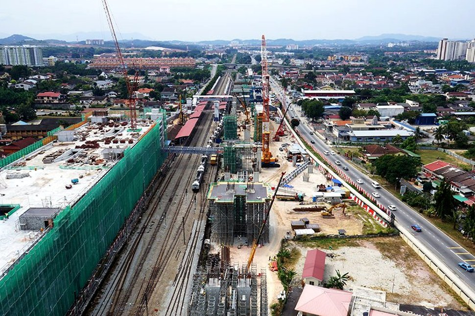 View of the construction of the Kajang MRT Station along Jalan Reko (right) and the Kajang Station Multi Storey Park and Ride Building on the left. Feb 2015
