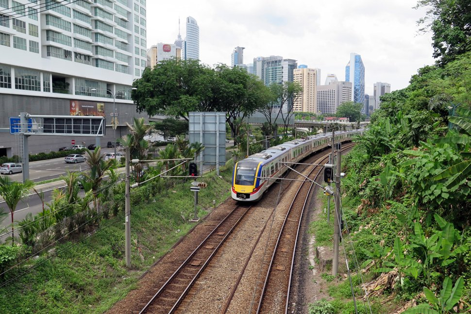 Train approaching the Putra KTM Komuter station