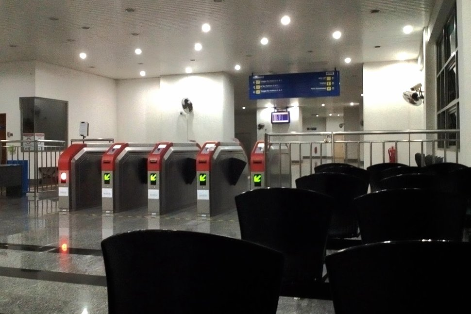 Faregates and waiting area at the station