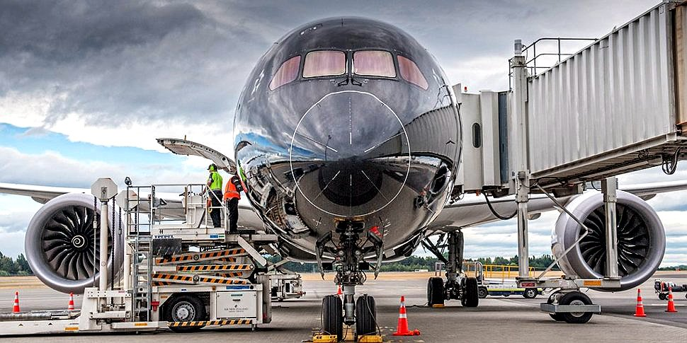 Crew attending and servicing Air New Zealand Flight