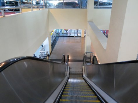 Use the escalator to go down to Level 1