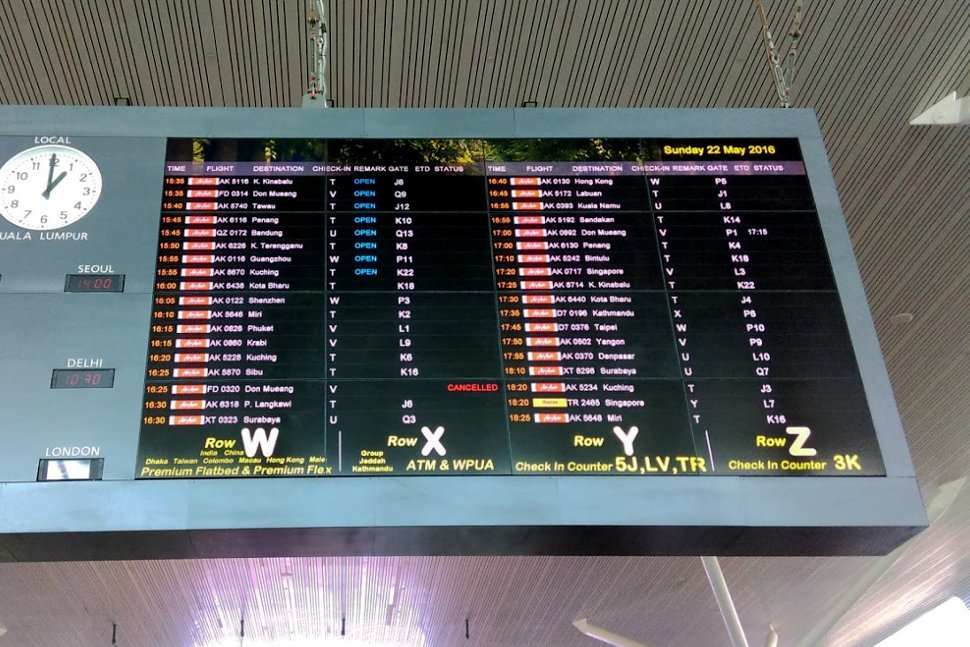 Giant monitor at the Departure Hall showing the flight schedule and status