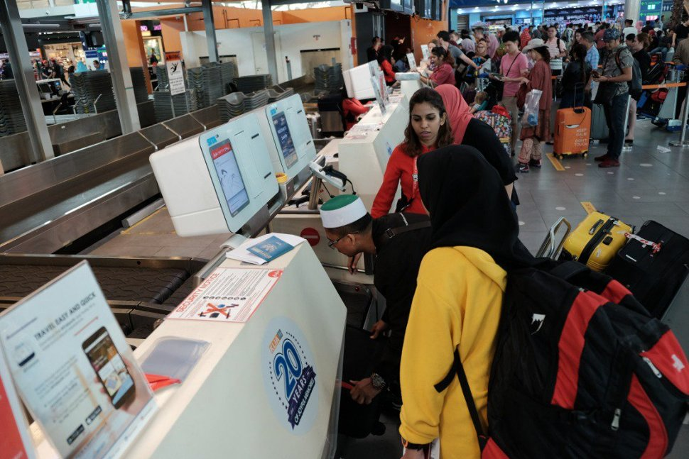 Passengers using the new self-bag drop facility at klia2