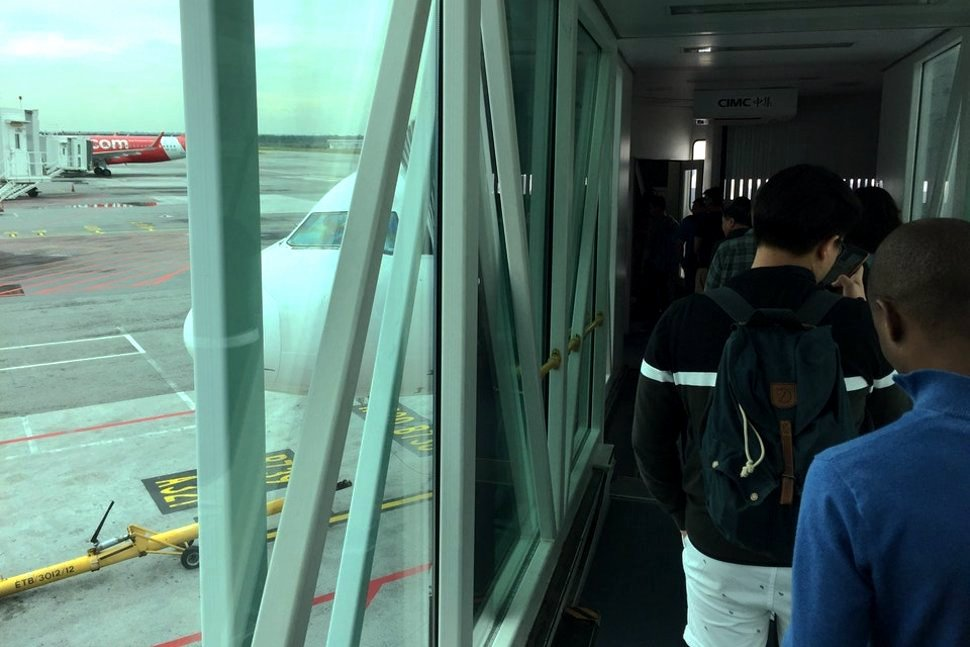 Passengers boarding the flight at Pier L