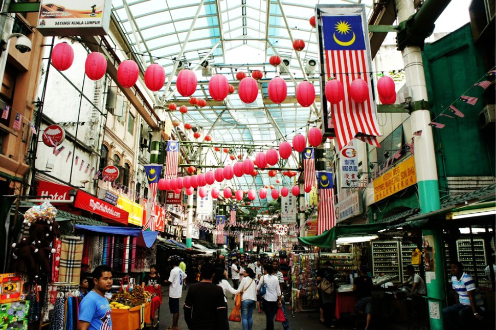 Walking along Petaling Street's fleat market
