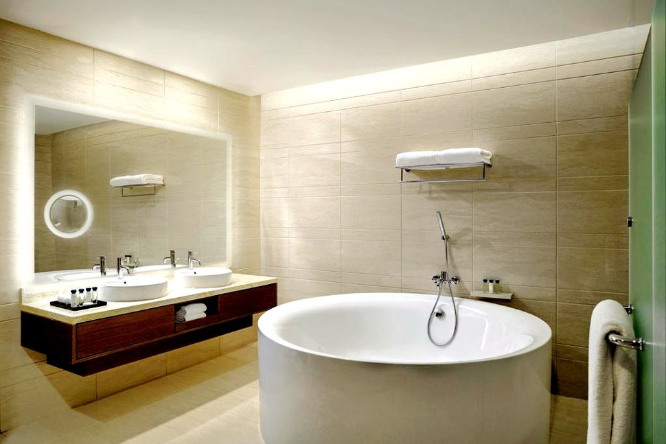 Spacious bathroom with bathtub