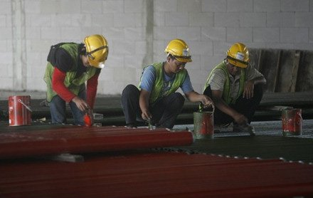 Workers preparing piping work, 29 Nov 2011