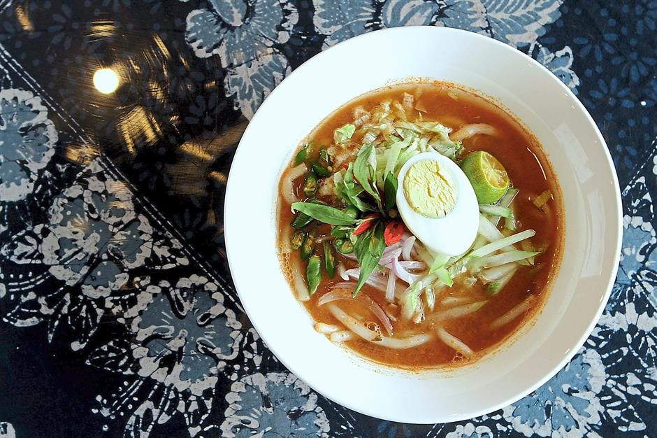 The Penang-style Asam Laksa gets a thumbs up. Photo: The Star/Yap Chee Hong