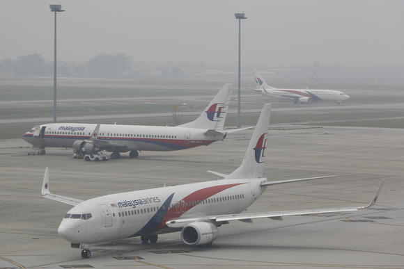 Widespread haze from forest fires in Indonesia's Sumatra and Borneo have only added to the woes of Malaysia's aviation sector.