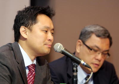 Tee (left) and Bina Puri CFO David Lee at the fund managers' briefing in Kuala Lumpur yesterday.