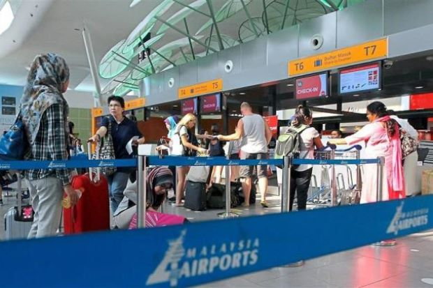 Travellers in queue to check in at klia2