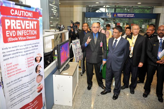 Dr Subramaniam (middle) being briefed of the Ebola screening measures at KLIA
