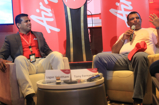 AirAsia Singapore CEO Logan Velaitham (left) and Fernandes explaining AirAsia's digitalisation plans to the media in Singapore today.