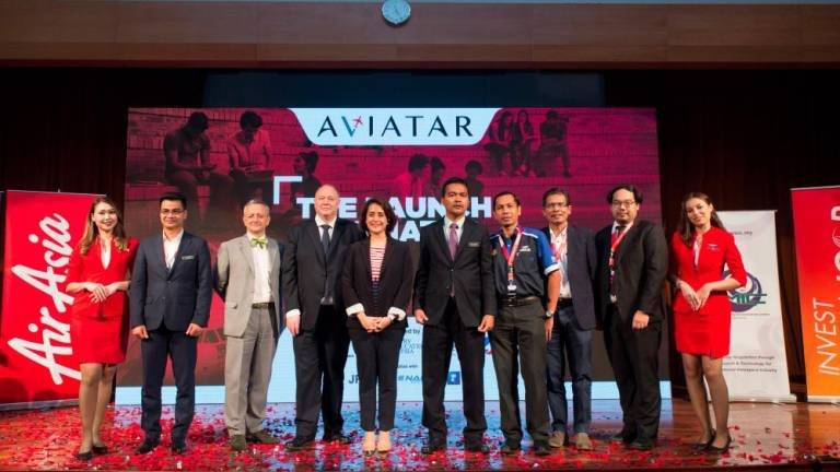 Aireen (fifth from left) and Dr Mohd Nor at the launch of Aviatar 2019. — Sunpix by Amirul Syafiq Mohd Din