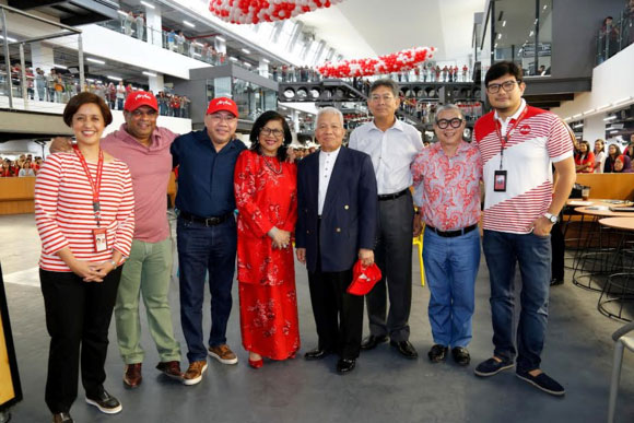 Executives from AirAsia and AirAsia X with Malaysian Aviation Commission executive chairman, Mohamed Khadar, fifth from left, at the airline's new corporate office, RedQ.