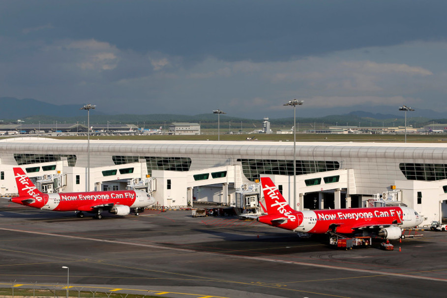 AirAsia planes are seen parked on the tarmac at Kuala Lumpur International Airport 2 (klia2) in Sepang, Malaysia February 15, 2016.