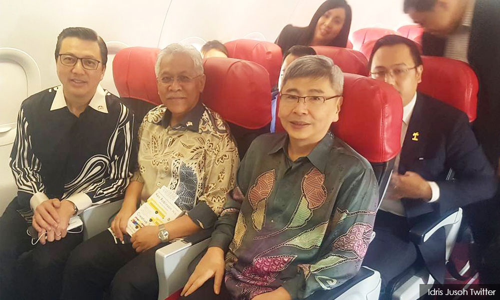 Ministers flying with AirAsia