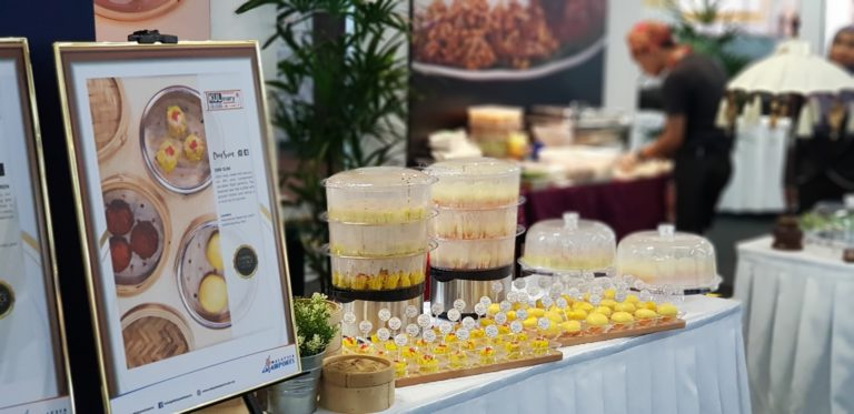 Dim Sum's certificate confirming its place in the top 20 stands proudly alongside some of its dishes.