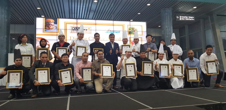 KULinary excellence: Chefs and representatives of Popeyes, Dim Sum, The Living Room and Dewina Host Malaysia are pictured with their counterparts from other successful restaurants named in KLIA's top 20.