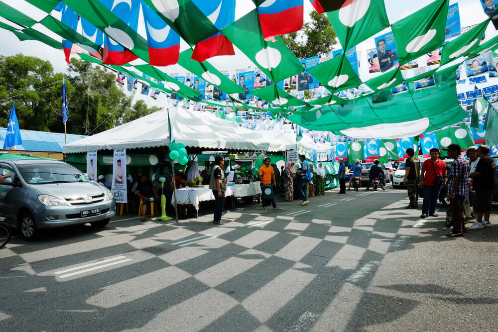 The colorful political party flags add a festive flair to the Malaysian general election.