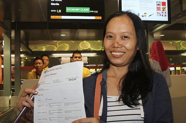Gemma Camarinta, 39, was the first person to check in for her Cebu Pacific Air flight.