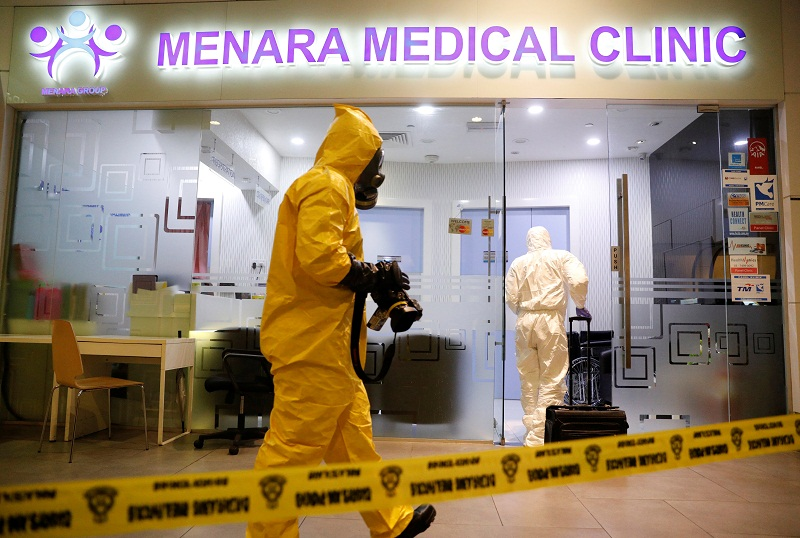 A Hazmat team conducts checks at a clinic at klia2 airport terminal in Sepang February 26, 2017. - Reuters pic