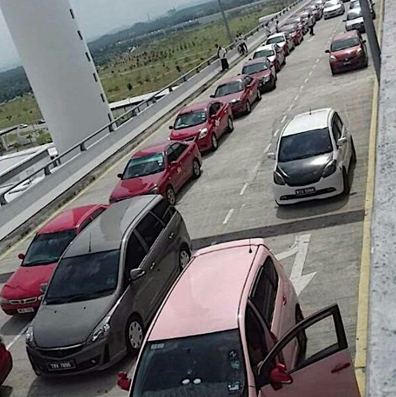 Vehicles on the road shoulder leading up to KL International Airport (KLIA) and KL International Airport 2