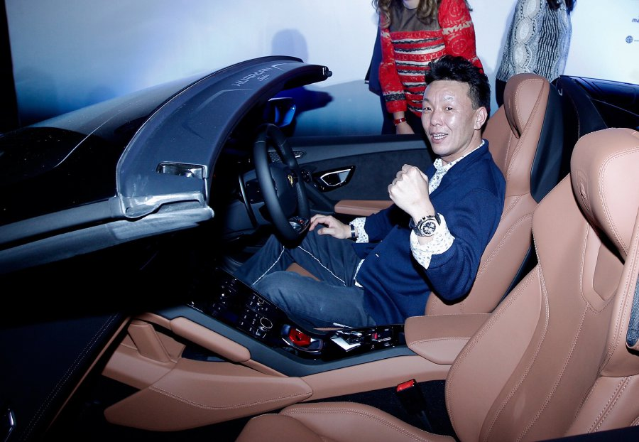 Riyo Kawakami sits in his Lamborghini Huracan Spyder during the Malaysia Airports Holdings Bhd's (MAHB) 25th Anniversary Shopping Campaign