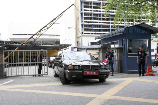 The car of ambassador of North Korea to Malaysia is leaving the forensic department at the hospital in Kuala Lumpur.