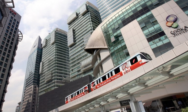 An LRT train passes the KL Sentral building in Kuala Lumpur