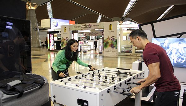 Travellers can also participate in a game of foosball.