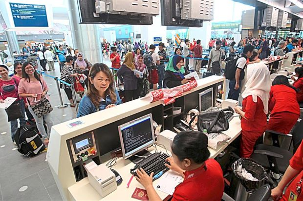 Large crowd: Customers queuing at counters at the newly opened klia2.