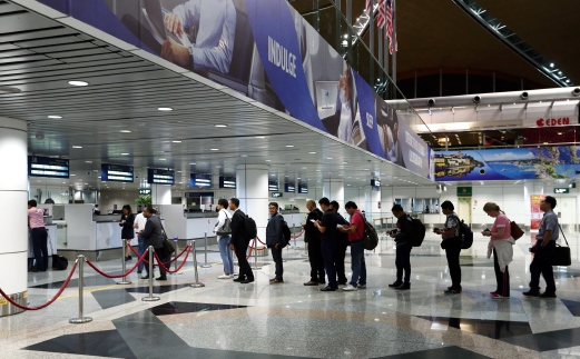 Travellers queuing up at the Immigration counter at Kuala Lumpur International Airport recently