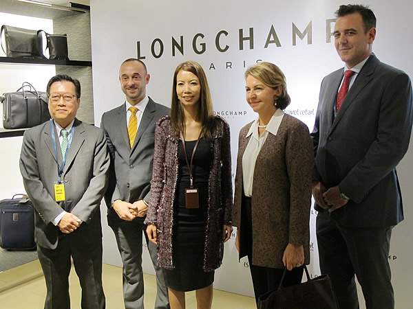 (L-R) LS travel retail Singapore General Manager Lee Charn Cheng