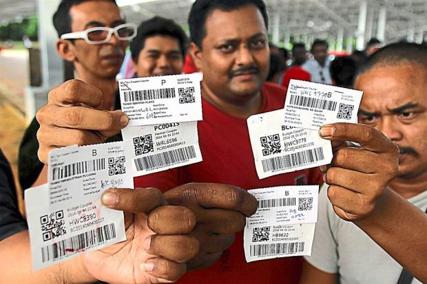 Livelihood under threat: klia2 taxi drivers showing coupons to prove it is difficult to get more than two trips per day.