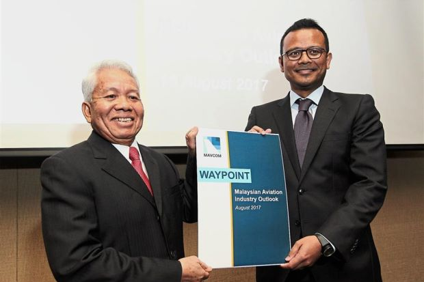 Mavcom executive chairman Tan Sri Abdullah Ahmad (left)